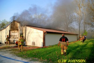 FF`s Pull Hose to South End As Flames Vent Roof