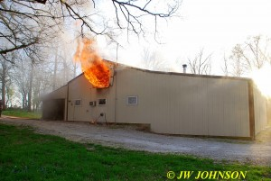 Heavy Fire Rolls Out Vent Above Home End