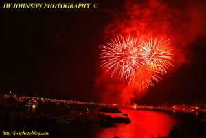 Bright Red Bursts Above Bay