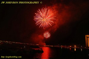 Bright Red Bursts Over Bay