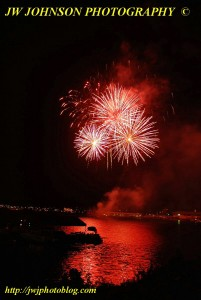 Red Bursts Over Bay