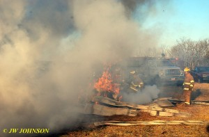 Hay Bale on Fire by Barn
