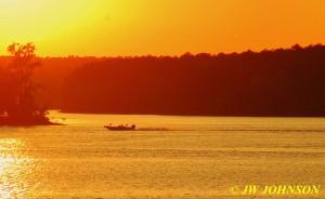 06 Speedboat Races Across Lake Sunset