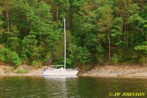 76 Sailboat Moored in Cove
