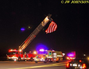 11 BFD Engine 60 Passes Under Flag