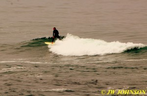 Surfer Rides The Waves 3