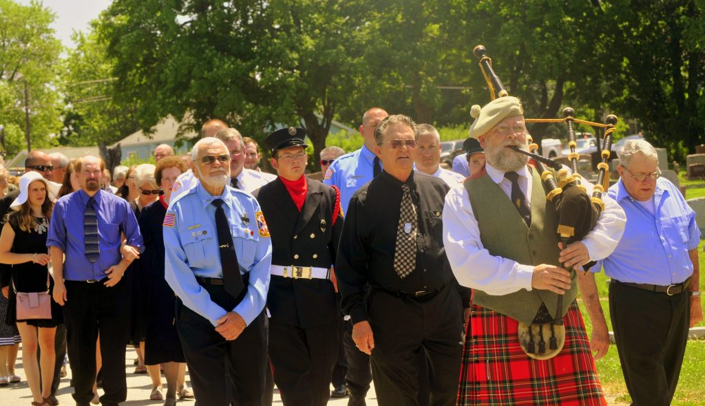 70 Procession Enters Cemetery